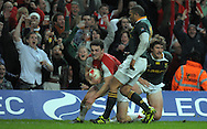 Photo © TOM DWYER / SECONDS LEFT IMAGES 2010 - Rugby Union - Invesco Perpetual Series - Wales v South Africa - 13/11/10 - Wales' George North beats the tackle of South Africa's Francois Steyn to score in the second half and celebrates - at Millennium Stadium Cardiff Wales UK -  All rights reserved