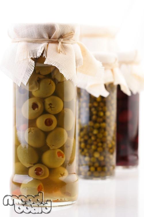 Pickled olives in jar - studio shot