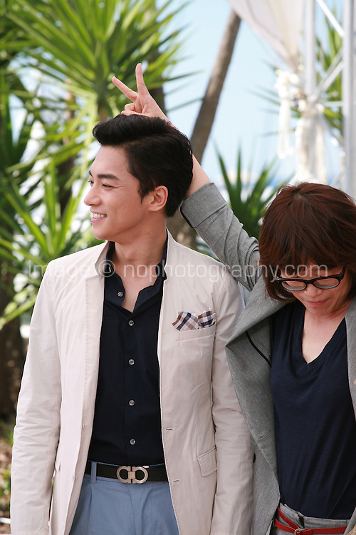 Actor Kim Young-Min, Director Shin Su-Won, at the Madonna film photo call at the 68th Cannes Film Festival Tuesday May 20th 2015, Cannes, France.