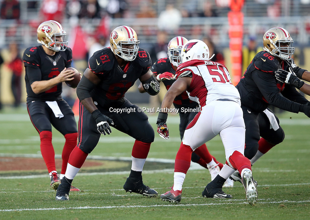San Francisco 49ers guard Andrew Tiller (61) blocks Arizona Cardinals middle linebacker Kevin Minter (51) during the 2015 week 12 regular season NFL football game against the Arizona Cardinals on Sunday, Nov. 29, 2015 in Santa Clara, Calif. The Cardinals won the game 19-13. (©Paul Anthony Spinelli)