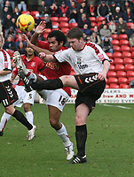 Photo: Mark Stephenson.<br />Walsall v Barnet. Coca Cola League 2. 24/02/2007. Walsall's (No.18) Kevin Harper fights for the ball
