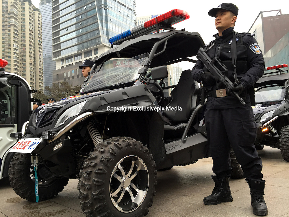 CHONGQING, CHINA - JANUARY 18: (CHINA OUT) A<br /> <br /> Armed Police officers stand by the four-wheel all-terrain motorcycle during a ceremony on January 18, 2016 in Chongqing, China. 110 new electric patrol cars and 6 four-wheel all-terrain motorcycles would be put into use during the Spring Festival in Jiangbei District of Chongqing. <br /> &copy;Exclusivepix Media