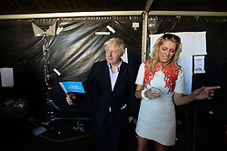 Celebration of the 2012 Olympic Games volunteering one year on. <br /> Mayor of London Boris Johnson backstage with British TV presenter Tess Daly.<br /> Mayor of London Boris Johnson and Lord Coe will be taking to the stage at Go Local to encourage a new drive in volunteering one year on from the Games. Also present are multi-platinum selling pop rock band McFly; world famous comedian Eddie Izzard, Brit Award nominated The Feeling, and Britain's Got Talent winners Attraction, in addition to stars Jack Carroll and Gabz. The event will be the UK's biggest ever celebration of volunteering and first Olympic and Paralympic legacy event at Queen Elizabeth Olympic Park.<br /> London, United Kingdom<br /> Friday, 19th July 2013<br /> Picture by Andrew Parsons / i-Images