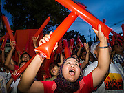 08 NOVEMBER 2015 - YANGON, MYANMAR: A National League for Democracy supporter cheers as another vote for the NLD was announced during the vote count Sunday. The vote count was shown live on television. The citizens of Myanmar went to the polls Sunday to vote in the most democratic elections since 1990. The National League for Democracy, (NLD) the party of Aung San Suu Kyi is widely expected to get the most votes in the election, but it is not certain if they will get enough votes to secure an outright victory. The polls opened at 6AM. In Yangon, some voters started lining up at 4AM and lines were reported to long in many polling stations in Myanmar's largest city.    PHOTO BY JACK KURTZ
