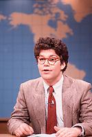 ca. 1986 --- Al Franken performs a Weekend Update skit on NBC's Saturday Night Live. --- Image by © Owen Franken/Corbis