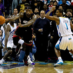 November 5, 2010; New Orleans, LA, USA;  Miami Heat small forward LeBron James (6) passes the ball as New Orleans Hornets small forward Trevor Ariza (1) and center Emeka Okafor (50) defend during a game at the New Orleans Arena. The Hornets defeated the Heat 96-93. Mandatory Credit: Derick E. Hingle