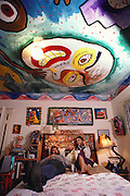 Artist, Mark Bulwinkle at home in Oakland, California in his bedroom with his first wife and a can of beer. MODEL RELEASED. USA.