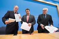 """15 MAY 2012, BERLIN/GERMANY:<br /> Peer Steinbrueck (L), SPD, Bundesminister a.D., Sigmar Gabriel (M), SPD Parteivorsitzender, Frank-Walter Steinmeier (R), SPD Fraktionsvorsitzender, mit Ihrem gemeinsamen Papier, nach der Pressekonferenz zum Thema """" Der Weg aus der Krise – Wachstum und Beschäftigung in Europa"""", Bundespressekonferenz<br /> IMAGE: 20120515-01-062<br /> KEYWORDS: Peer Steinbrück"""