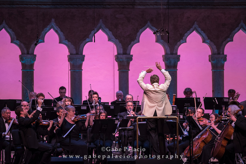 Rob Fisher, conductor, leads the Opening Night Concert with Orchestra of St. Luke's and  in the Venetian Theater at Caramoor in Katonah New York on June 18, 2016. <br /> (photo by Gabe Palacio)