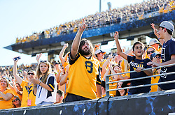 Oct 14, 2017; Morgantown, WV, USA; West Virginia Mountaineers fans celebrate during the fourth quarter against the Texas Tech Red Raiders at Milan Puskar Stadium. Mandatory Credit: Ben Queen-USA TODAY Sports