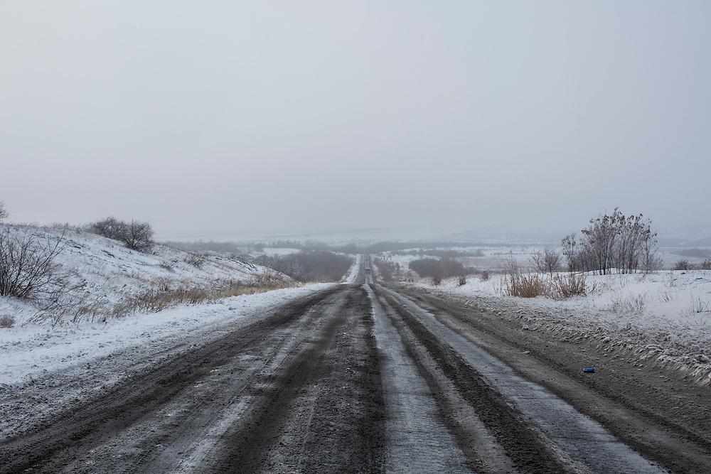IVANIVKA, UKRAINE - DECEMBER 8, 2014: The road between Donetsk and Luhansk in Ivanivka, Ukraine. CREDIT: Brendan Hoffman for The New York Times