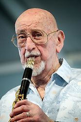 29 April 2012. New Orleans, Louisiana,  USA. <br /> New Orleans Jazz and Heritage Festival. <br /> Pete Fountain, legendary jazz clarinetist performs to an adoring crowd.<br /> Photo; Charlie Varley/varleypix.com