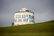 A Folkestone is an Art School banner, attached to Folkestone's most prominent Martello Tower on the east cliff. The banner has been designed by the artist Bob and Roberta Smith as part of the 2017 Folkestone Triennial. Folkestone, Kent.(photo by Andrew Aitchison / In pictures via Getty Images)