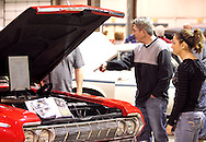 Harley (right) and father Billy Walters of Richmond look at Bev & George Stamper of West Milton's 1964 Plymouth Fury during the KOI Hot Rod Fest Dayton at the Dayton Airport Expo Center in Vandalia, Sunday, March 12, 2012.