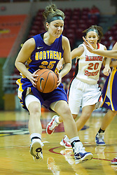 01 January 2011:  Lindsey Cain leaps to a stop during an NCAA Women's basketball game between the Northern Iowa Panthers and the Illinois State Redbirds at Redbird Arena in Normal Illinois.