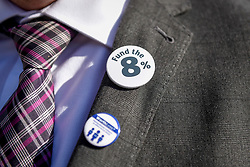 © Licensed to London News Pictures. 28/09/2018. LONDON, UK. A head teacher wears topical lapel badges joining hundreds of other head teachers at a rally in Parliament Square to demand extra funding for schools ahead of a petition being delivered to Number 11 Downing Street.  With a reported reduction in per student funding in real terms since 2010, members of the National Union of Head Teachers and the Association of School and College Leaders attending the rally also warn of increasing class sizes, staff cuts, and reduced subject choice.  Photo credit: Stephen Chung/LNP