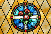 Rose floral stained glass window from a church wedding ceremony