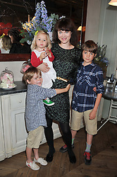 JASMINE GUINNESS with her children OTIS, RUBY & ELWOOD at a tea party to celebrate the launch of the limited edition Heart & Sole shoe collection by Step2wo in aid of the British Heart Foundation's Mending Broken Hearts Appeal, held at Aubaine on 2, Selfridge's, Oxford Street, London on 4th July 2012.