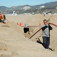Linemen from Los Angeles County Internal Services lay  copper telecom cable at Santa Monica Beach on Wednesday, January 25, 2012. The copper cables will be used for telephones in the lifeguard stations.