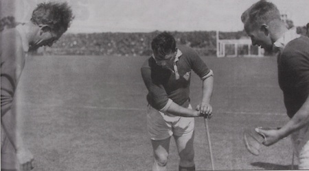 Mick Mahey and Christy Ring at the toss of the coin in the 1946 Munster Final.