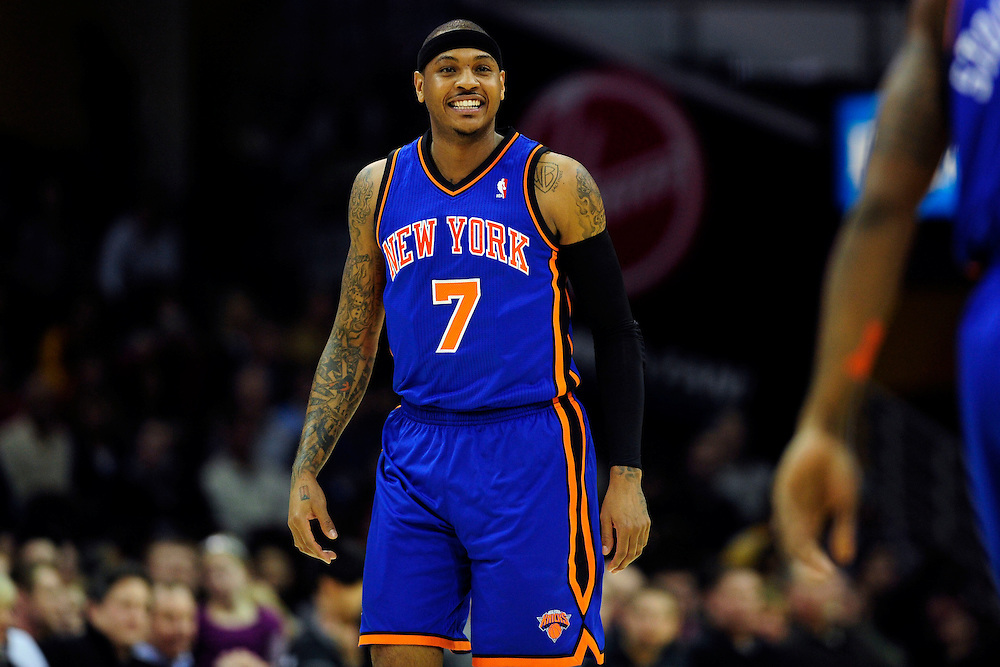 Feb. 25, 2011; Cleveland, OH, USA; New York Knicks small forward Carmelo Anthony (7) grins at a teammate during the first quarter against the Cleveland Cavaliers at Quicken Loans Arena. Mandatory Credit: Jason Miller-US PRESSWIRE