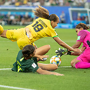 GRENOBLE, FRANCE June 18.  Trudi Carter #18 of Jamaica and goalkeeper Nicole McClure #13 of Jamaica combine to stop Sam Kerr #20 of Australia during the Jamaica V Australia, Group C match at the FIFA Women's World Cup at Stade des Alpes on June 18th 2019 in Grenoble, France. (Photo by Tim Clayton/Corbis via Getty Images)