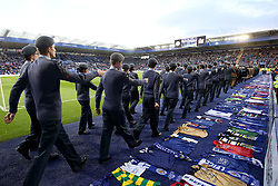 Armed forces march around the pitch during half time at the Leicester City v Burnley match