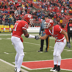 Dec 5, 2009; Piscataway, NJ, USA; Rutgers cornerback Devin Mccourty (21) and wide receiver Tim Brown (2) shake hands during the senior ceremony before first half NCAA Big East college football action between Rutgers and West Virginia at Rutgers Stadium.