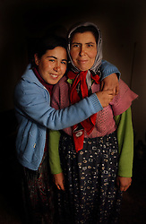 Ali Ipak 's wife Ayse poses with her daughter Emel, (in blue)  December 12, 2005 in central Turkey, Konya in Kutoren district, about 400 kilometers from Ankara.  (Ami Vitale)