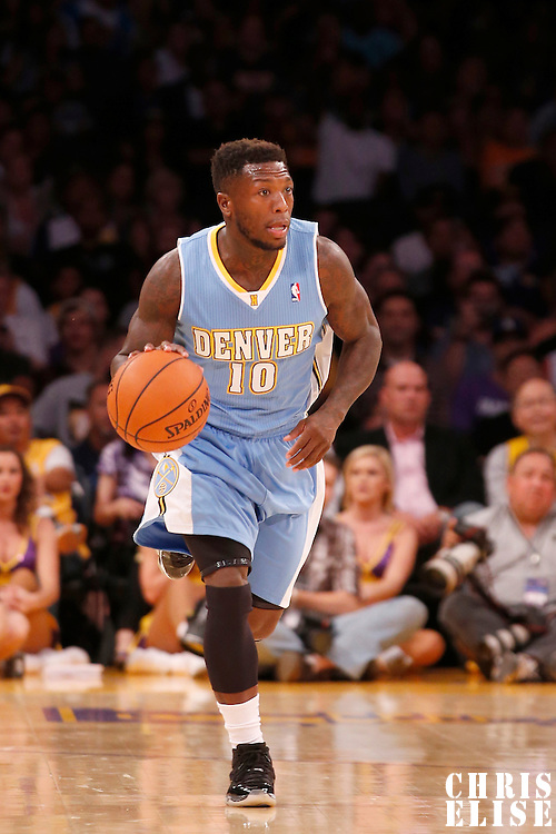 06 October 2013: Denver Nuggets point guard Nate Robinson (10) brings the ball upcourt during the Denver Nuggets 97-88 victory over the Los Angeles Lakers at the Staples Center, Los Angeles, California, USA.