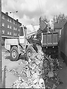 Army Removes Refuse In Dublin..1986..05.06.1986..06.05.1986..5th June 1986..Due to the ongoing strike by Dublin Corporation workers,the army were called in to help clear some of the mounds of rubbish stacking up around the city. Health worries from the rotting rubbish and the danger of rat infestation caused the intervention. The 2nd Garrison Supply and Transport Company,McKee Barracks,Dublin were delegated to clear the rubbish from St Theresa's Flats,Donore Avenue,Dublin...Image shows that the army were winning the rubbish war as the mounds of rubbish reduces dramatically.