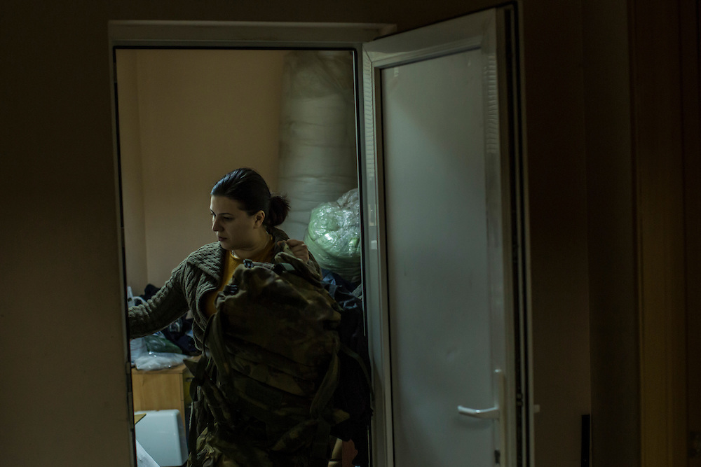DNIPROPETROVSK, UKRAINE - NOVEMBER 16, 2014:  Natalia Naumenko, 38, the owner of a travel agency, at the Dnipropetrovsk Volunteer Logistics Center, a charity organization that produces supplies for pro-Ukrainian fighters battling rebels in the country's East, in Dnipropetrovsk, Ukraine. CREDIT: Brendan Hoffman for The New York Times