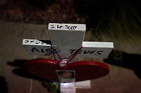 A marker for Alex Teves, killed in the Aurora theater shooting, is seen at a vigil on the 5 year anniversary of the tragedy in Aurora, Colorado July 20, 2017.  REUTERS/Rick Wilking