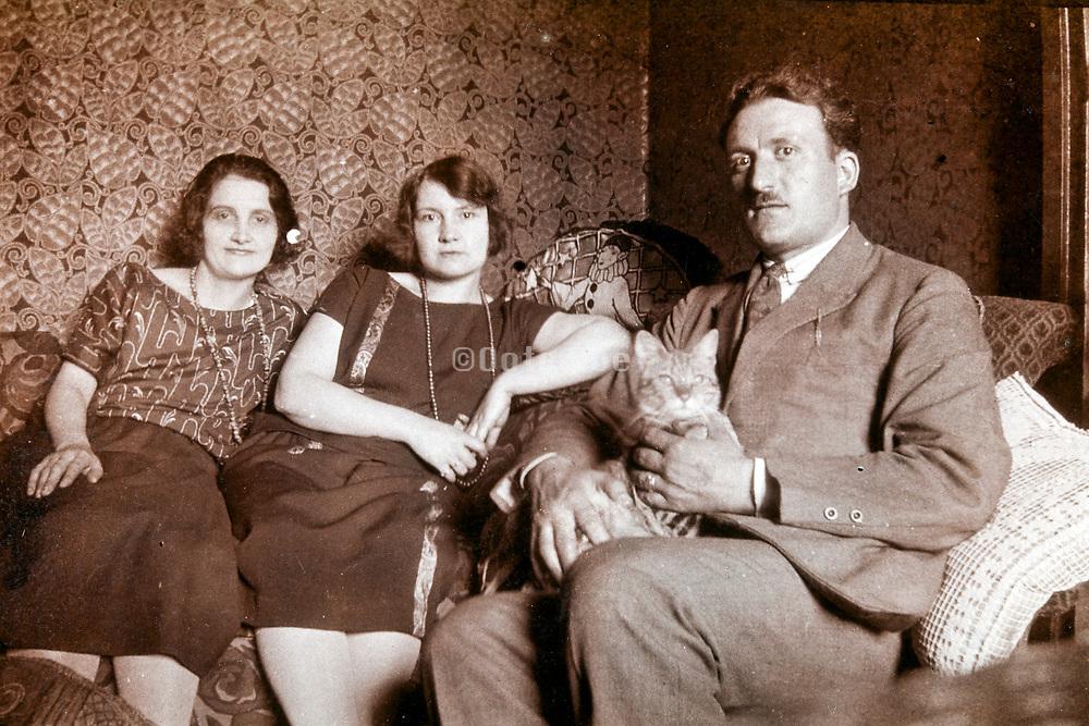 adult people indoors sitting 1930s