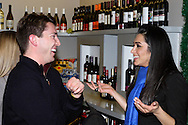 Luke Notestine of Fox 45/ABC 22 (left) and Maha Kashani of Cincinnati Bell during the Generation Dayton annual holiday wine tasting at Winan's Chocolates and Coffees near the Dayton Mall in Miami Township, Thursday, December 1, 2011.