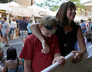 Michele Gilman, right, and Alex Gilman, 13, enjoy the music on Gibbs Street at the Xerox Rochester International Jazz Festival on Saturday, June 21, 2014.