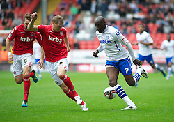 LONDON, ENGLAND - Saturday, October 8, 2011: Tranmere Rovers' Enoch Showunmi and Charlton Athletic's Matt Taylor in action during the Football League One match at The Valley. (Pic by Gareth Davies/Propaganda)