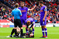 Shaun MacDonald of Rotherham United checks on an injured Lewis Price of Rotherham United - Mandatory by-line: Ryan Crockett/JMP - 07/09/2019 - FOOTBALL - The Keepmoat Stadium - Doncaster, England - Doncaster Rovers v Rotherham United - Sky Bet League One