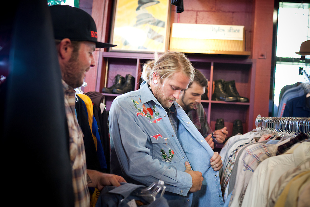 Santa Rosa residents Cody Brown, 29, right, CJ Elmore, 27, center, and Justin Woldruff, 24, right, shop at Aubergine Vintage Emporium, in Sebastopol, CA., on Saturday, Oct 9, 2011. In recent years, new restaurants, shops and live music venues have opened in Sebastopol, securing the town as an arts and culture hub.