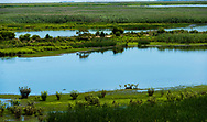 Blue marsh waters and green grasses abound in the Marshes