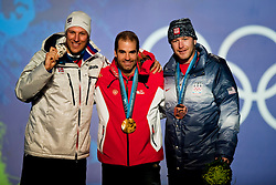 Olympic Winter Games Vancouver 2010 - Olympische Winter Spiele Vancouver 2010, Alpine Skiing (Men's Downhill), Aksel Lund Svindal, NOR, (L), Didier Defago, SUI, and Bode Miller, USA, (R) pose for the crowd after accepting their medals for the Men's Downhill during the 2010 Vancouver Winter Olympics at Whistler Celebration Site in Whistler, British Columbia, Monday, Feb. 15, 2010.  *** Photo by newsport / HOCH ZWEI / SPORTIDA.com.