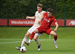 KIRKBY, ENGLAND - Saturday, August 31, 2019: Liverpool's Layton Stewart and Manchester United's William Fish during the Under-18 FA Premier League match between Liverpool FC and Manchester United at the Liverpool Academy. (Pic by David Rawcliffe/Propaganda)
