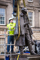 The sculpture of Sherlock Holmes by former pop-artist Gerald Laing is being moved from it's home on Picardy Place, yards from the birth place of Sir Arthur Conan Doyle.<br /> <br /> The move of the sculpture is to accommodate road and tram works that are taking place in Edinburgh. The statue will be moved to Nairn at  Black Isle Bronze Ltd by the artists son, Farquhar Laing where it will stay for two years until it returns to Edinburgh.<br /> <br /> Pictured: Lifting straps are passed around the statue
