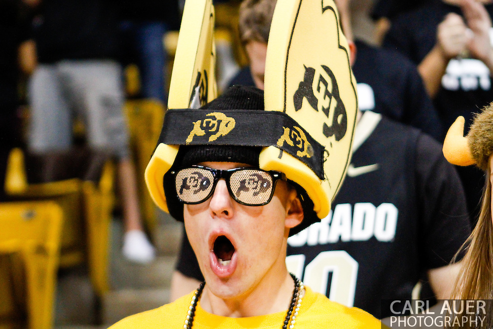 November 16th, 2013:  A Colorado student cheers as the Buffaloes are introduced prior to the start of action in the NCAA Basketball game between the Jackson State Tigers and the University of Colorado Buffaloes at the Coors Events Center in Boulder, Colorado