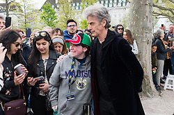 Actor Peter Capaldi who plays Dr Who poses  for photos with fans on a 3D Alien Landscape painting to celebrate new TV series of Dr Who.