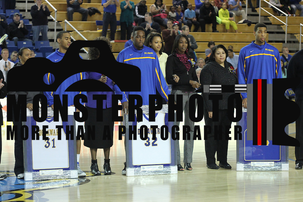 Three Delaware seniors Delaware Guard Will Townsville (31), Delaware Forward Josh Brinkley (32) and Delaware Forward Jamelle Hagins (44) honored prior to a regular season NCAA basketball game against George Mason Saturday, March 2, 2013 at the Bob Carpenter Center in Newark Delaware.