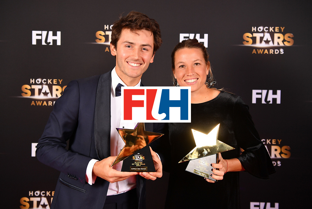 BERLIN, GERMANY - FEBRUARY 05:  Arthur van Doren  of Belgium  and Delfina Merino  of Argentina hold their awards for player of the year during the Hockey Star Awards night at Stilwerk on February 5, 2018 in Berlin, Germany.  (Photo by Stuart Franklin/Getty Images For FIH)