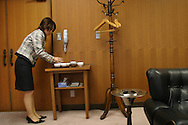 An employee at Suzuki Motor Corporation prepares cups of tea for the president of the company and his guests, in a boardroom, in Hamamatsu, Japan, on Tuesday, Apr 25th 2006. During interviews and meetings it is common for female assistants to enter the rooms silently , bringing refreshment drinks of green tea, coffee, or orange juice, to the company head and his guests.