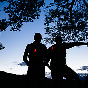 Two athletes run trails near the Teton Mountain Range near Jackson, Wyoming.