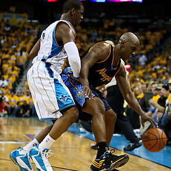 25 April 2009: New Orleans Hornets guard Chris Paul (3) guards Denver Nuggets guard Chauncey Billups (7) during a 95-93 win by the New Orleans Hornets over the Denver Nuggets in game three of the NBA Western Conference quarter-finals playoff at the New Orleans Arena in New Orleans, Louisiana.